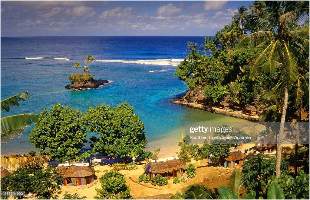Cluster of tourist beach huts, The Island of Upolu, Western Samoa.