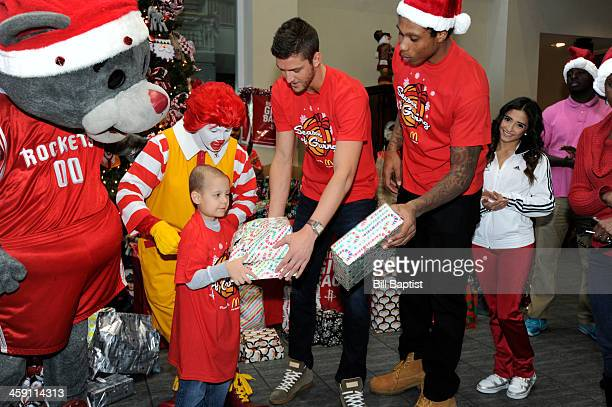 Clutch Mascot Chandler Parsons and Greg Smith of the Houston Rockets visit and pass out gifts to children on December 16 2013 at the Ronald McDonald...