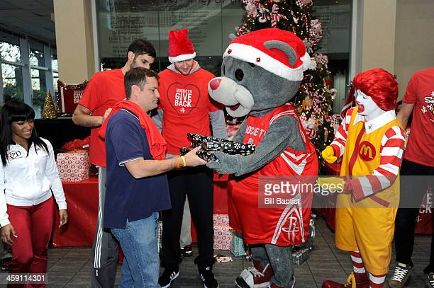 Clutch Mascot Omri Casspi and Donatas Motiejunas of the Houston Rockets visit and pass out gifts to children on December 16 2013 at the Ronald...