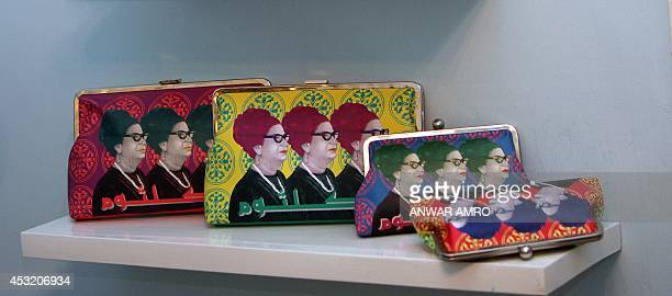 YAZBECK Clutches bearing the image of Egyptian diva Umm Kulthum are displayed in the showroom of Sarah's Bag in Beirut on March 24 2010 The...