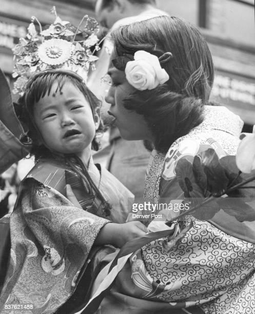 Clutching her wax lotus blossoms Georgiann Fukuhara 2½ of 2824 California street wails despondently during Chigo parade Sunday preceding the...