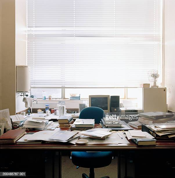 Cluttered desk in office
