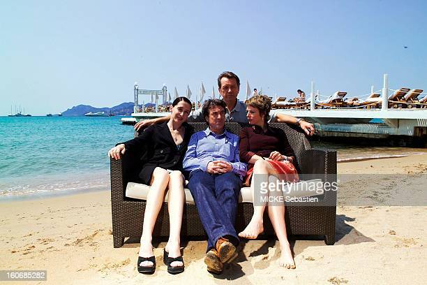 Cluzet Bernard Giraudeau Anne Brochet and Karin Viard barefoot posing in a sofa on the beach of the Z'' Martinez Hotel in Cannes to promote the film...