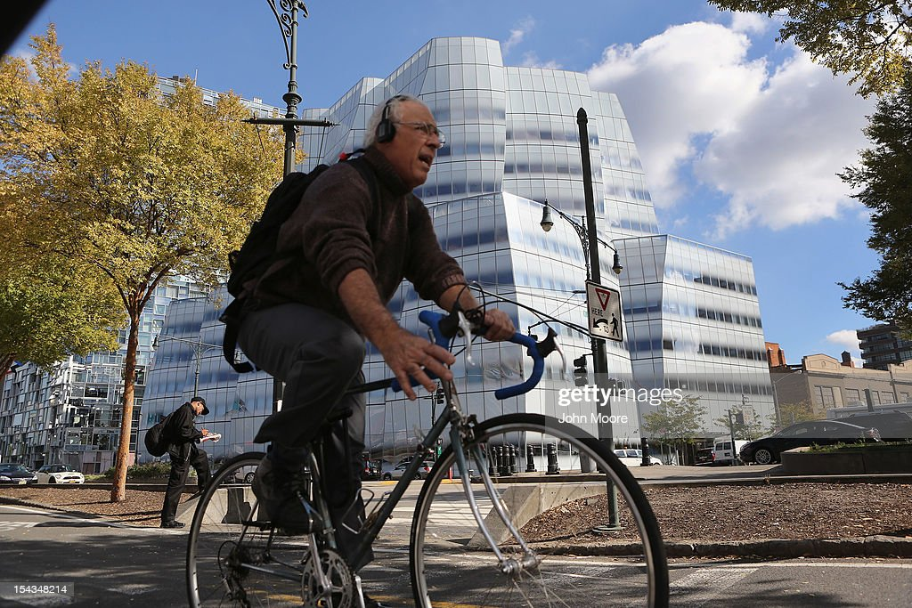 A clyclist passes by the Newsweek Magazine office located in the Frank Gehry-designed IAC building in Manhattan's Chelsea neighborhood on October 18, 2012 in New York City. Tina Brown, editor-in-chief of The Newsweek Daily Beast Co, announced today that the 80-year-old news magazine will publish its final print edition on December 31 and shift to an all-digital format in early 2013. Staff layoffs are expected.
