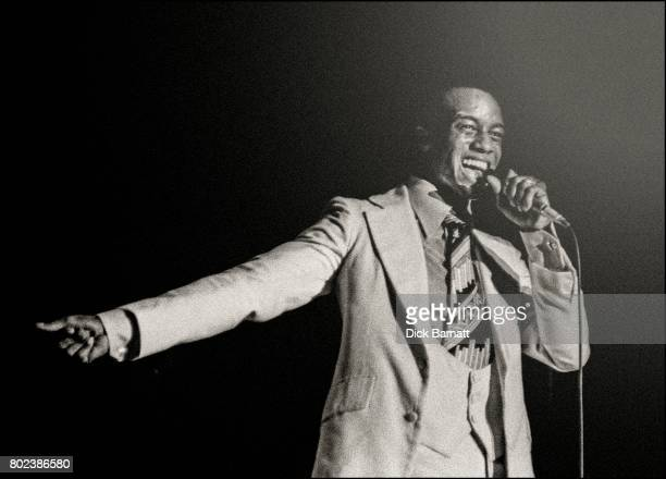 Clyde Brown of The Drifters performing on stage at Hammersmith Odeon London 12th October 1975