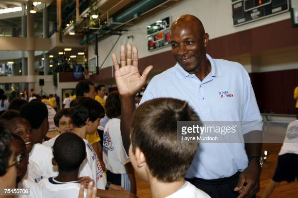 Clyde Drexler NBA legend works with campers as the New Orleans AllStar logo is unveiled at the Jr NBA/Jr WNBA Basketball Camp on July 17 2007 at the...