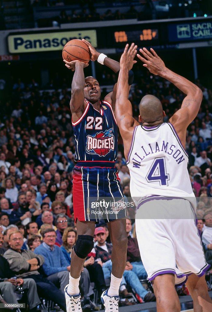 Clyde Drexler of the Houston Rockets shoots against the Sacramento Kings circa 1997 at Arco Arena in Sacramento California NOTE TO USER User...