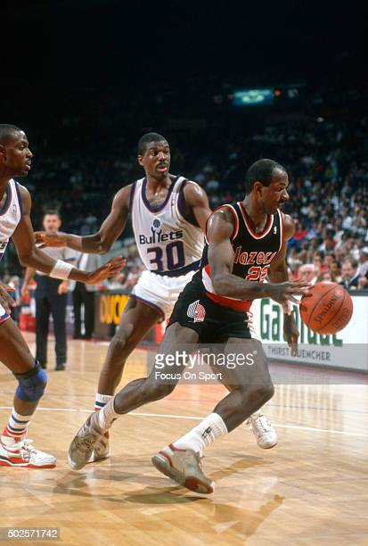Clyde Drexler of the Portland Trail Blazers dribbles the ball against the Washington Bullets during an NBA basketball game circa 1990 at the Capital...