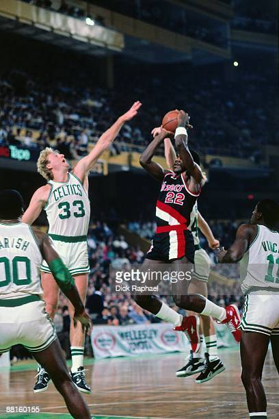 Clyde Drexler of the Portland Trail Blazers shoots a jumper against Larry Bird of the Boston Celtics during a game played on December 6 1985 at the...