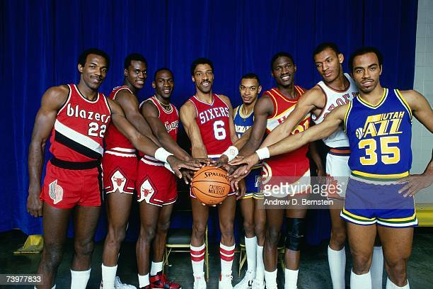 Clyde Drexler Orlando Woolridge Michael Jordan Julius Erving Terrence Stansbury Dominique Wilkins Larry Nance and Darrell Griffith pose for a...