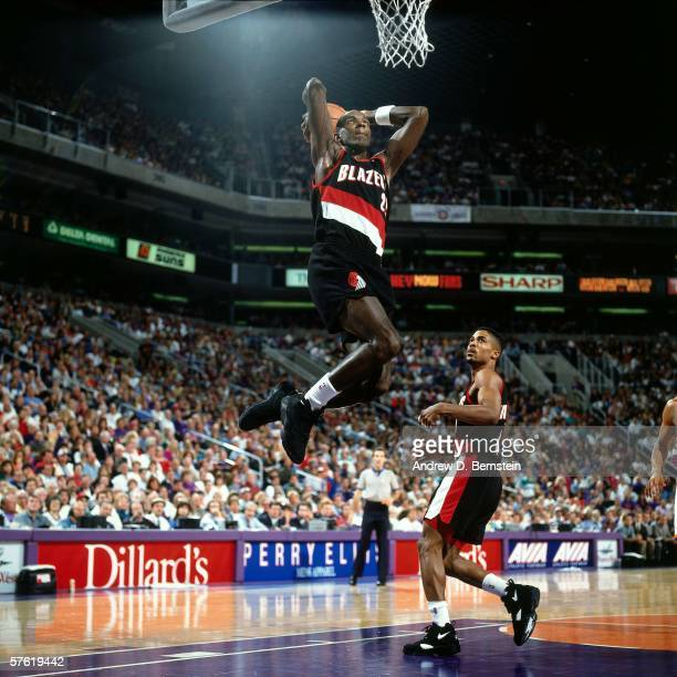 Clyde Drexler#22 of the Portland Trail Blazers dunks against the Phoenix Suns during a game at America West Arena on November 19 1994 in Phoenix...