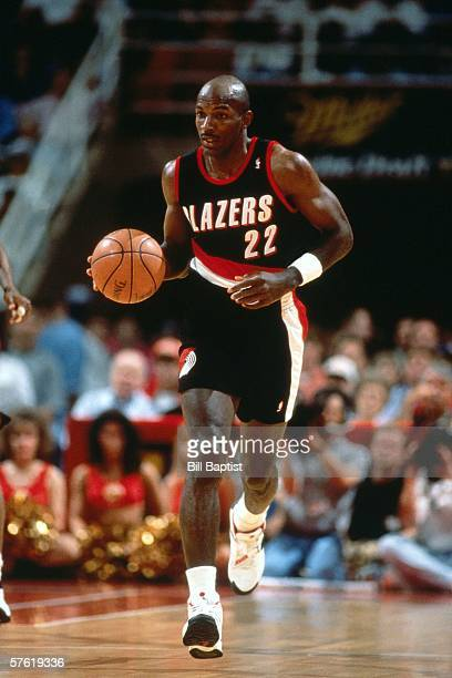 Clyde Drexler#22 of the Portland Trail Blazers moves the ball up court during a game against the Houston Rockets at The Summit in 1994 in Houston...