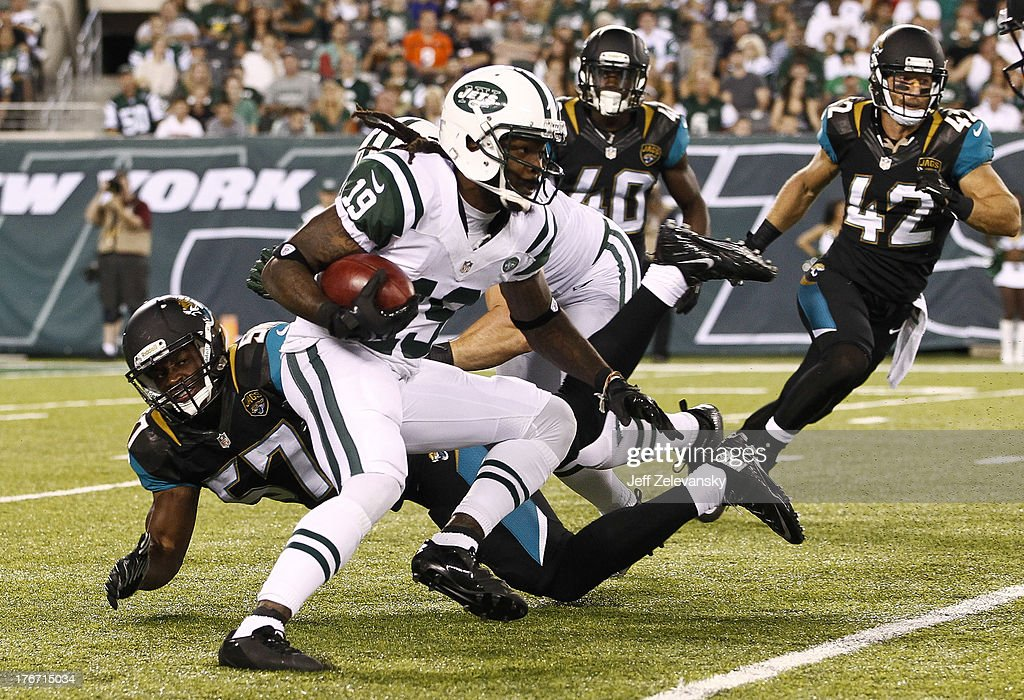 Clyde Gates #19 of the New York Jets dodges Julian Stanford #57 of the Jacksonville Jaguars during their preseason game at MetLife Stadium on August 17, 2013 in East Rutherford, New Jersey.
