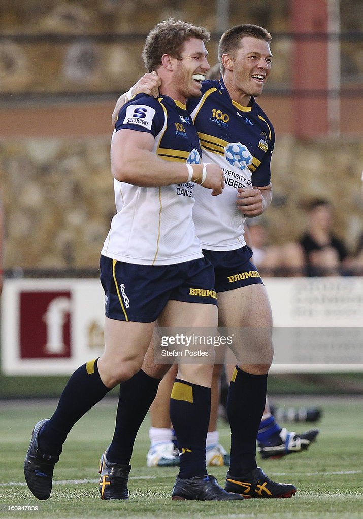Clyde Rathbone and David Pocock of the Brumbies celebrate a try during the Super Rugby trial match between the Brumbies and the ACT XV at Viking Park on February 8, 2013 in Canberra, Australia.