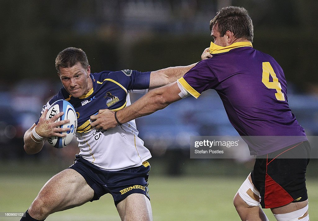 Clyde Rathbone of the Brumbies is tackled by Gareth Clouston of the ACT XV during the Super Rugby trial match between the Brumbies and the ACT XV at Viking Park on February 8, 2013 in Canberra, Australia.