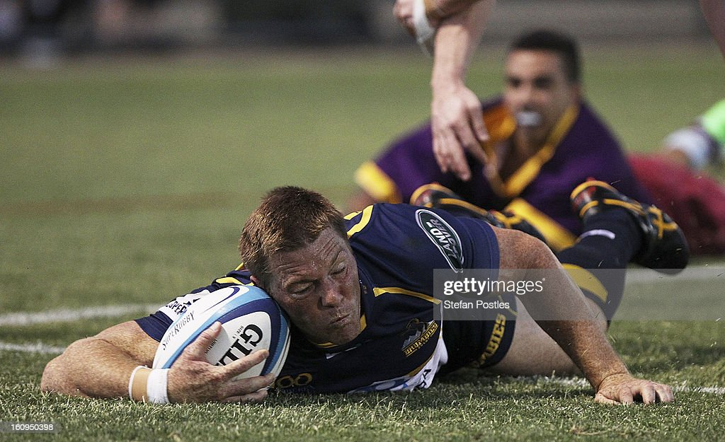 Clyde Rathbone of the Brumbies scores a try during the Super Rugby trial match between the Brumbies and the ACT XV at Viking Park on February 8, 2013 in Canberra, Australia.