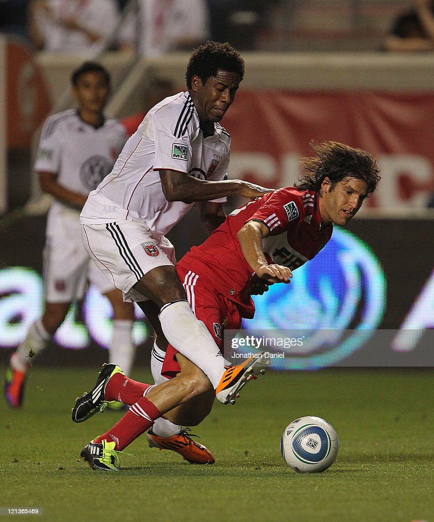 Clyde Simms of DC United shoves Sebastian Grazzini of the Chicago Fire to the ground earning a yellow card during an MLS match at Toyota Park on...