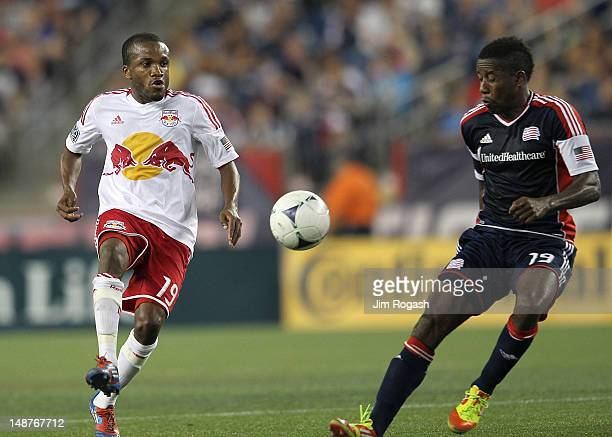 Clyde Simms of the New England Revolution battles Dane Richards of the New York Red Bulls at Gillette Stadium July 8 2012 in Foxboro Massachusetts