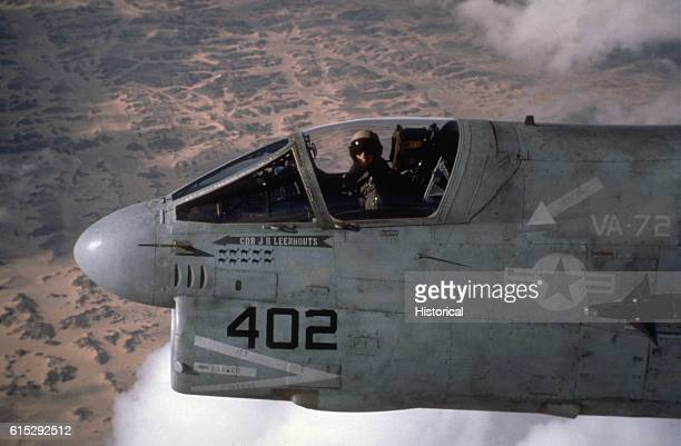 Cmdr John R Leenhouts executive officer of Attack Squadron 72 pilots his A7E Corsair aircraft over the desert on his return flight to the aircraft...