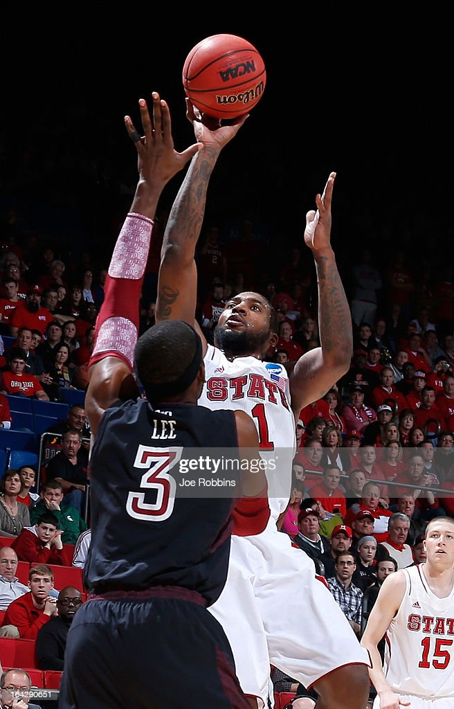 cn1 shoots over Anthony Lee of the Temple Owls in the first half during the second round of the 2013 NCAA Men's Basketball Tournament at UD Arena on...