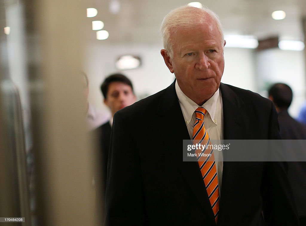 Co- Chairman Saxby Chambliss (R-GA) walks to a closed door U.S. Senate Intelligence Committee meeting, June 13, 2013 in Washington, DC. The committee is hearing testimony from members of the intelligence community on the collection of personal data that helped the NSA thwart a number of terror plots from ever unfolding both domestically and abroad.