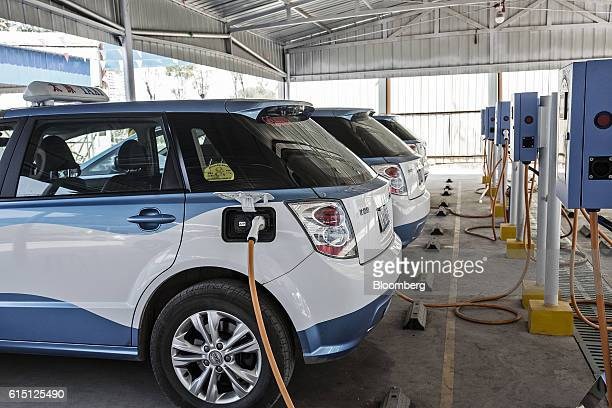 BYD Co E6 electric taxis stand plugged in to chargers at a charging station in Taiyuan Shanxi province China on Tuesday Sept 13 2016 Taiyuan became...