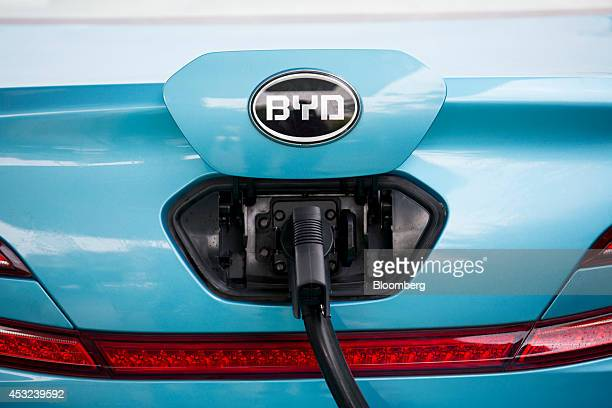 Co electronic vehicle is charged at an EV charging station at the company's campus in the Pingshan district of Shenzhen China on Tuesday Aug 5 2014...