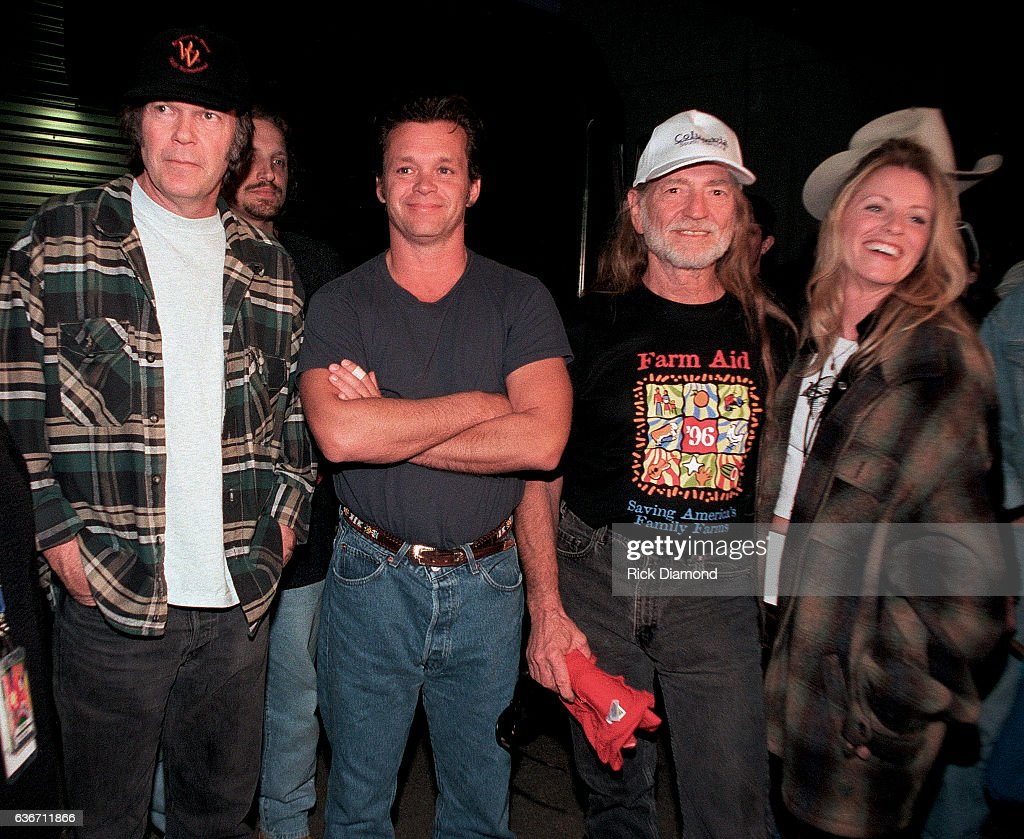 Co - Founders Neil Young, John Mellencamp and Willie Nelson with Singer/Songwriter Deana Carter backstage during Farm Aid 1996 hosted by Hootie & the Blowfish at William - Brice Stadium on the campus of USC in Columbia South Carolina October 12, 1996.
