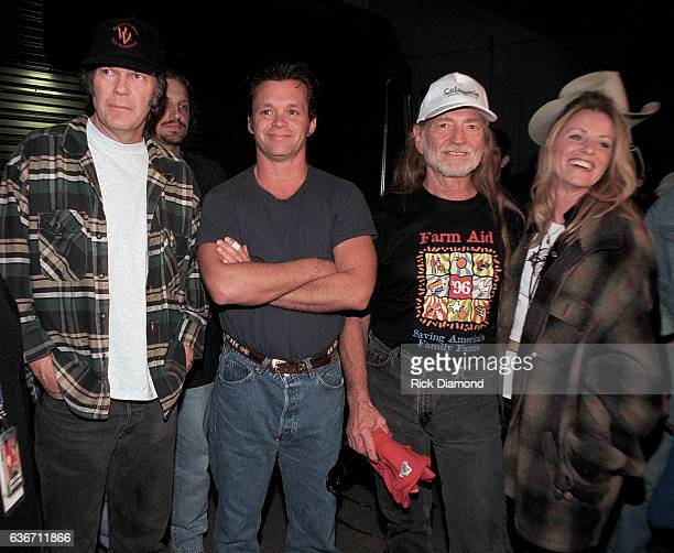 Co Founders Neil Young John Mellencamp and Willie Nelson with Singer/Songwriter Deana Carter backstage during Farm Aid 1996 hosted by Hootie the...