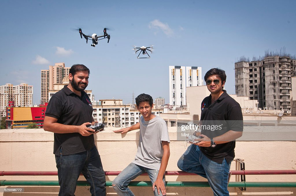 Co - founders Rahat Kulshreshtha and Gaurav Mehta, along with Neil Gokhale- Engineering Head- of Quidich poses with model prepared by them on May 18, 2015 in Mumbai, India.