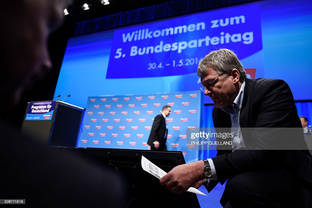 Co- leader of the german right wing party Alternative for Germany (AfD) Joerg Meuthen reads a letter allegedly linked to a hacker attack during a party congress of the German right wing party AfD (Alternative fuer Deutschland) at the Stuttgart Congress Centre ICS on May 1, 2016 in Stuttgart, southern Germany. / AFP / Philipp GUELLAND