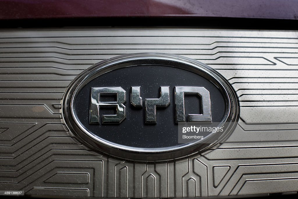 Co. Ltd. badge is seen on an e6 all-electric vehicle in New York, U.S., on Friday, Dec. 20, 2013. BYD Co., the Chinese automaker part-owned by Berkshire Hathaway Inc., expects auto sales and profit to increase in the fourth quarter, a traditional peak season for car sales, driven by demand for models including the Speed sedan and S6 SUV. Photographer: Victor J. Blue/Bloomberg via Getty Images