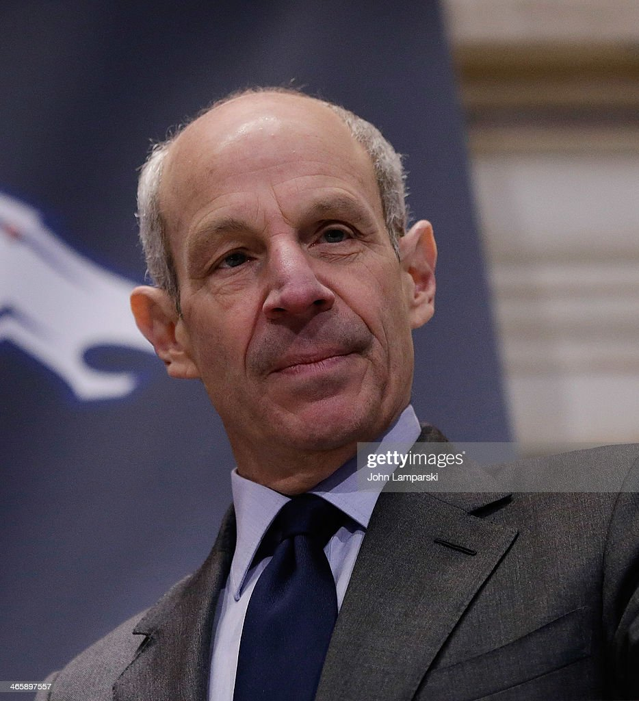 Co- owner of the NY Giants John Tisch rings the opening bell at New York Stock Exchange on January 30, 2014 in New York City.