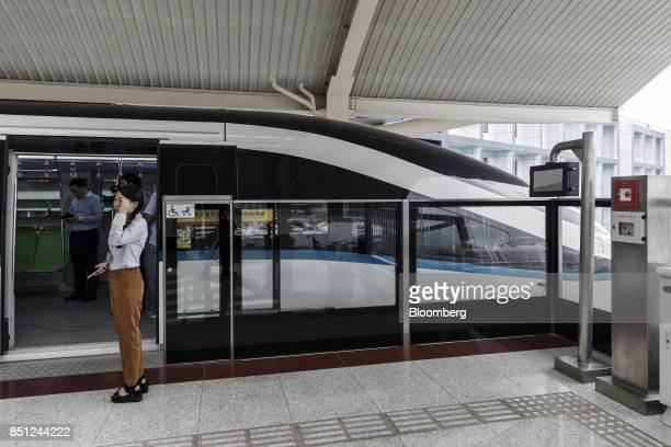 Co SkyRail monorail train stands at a station at the company's headquarters in Shenzhen China on Thursday Sept 21 2017 China will likely order an end...