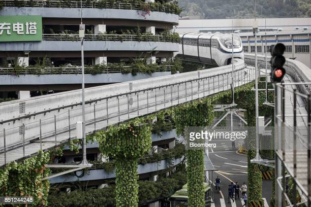 Co SkyRail monorail train travels on an elevated track at the company's headquarters in Shenzhen China on Thursday Sept 21 2017 China will likely...
