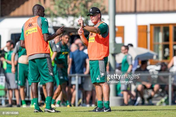 Co Trainer Otto Addo talk to Head Coach Dieter Hecking during a training session at the Training Camp of Borussia Moenchengladbach on July 19 2017 in...