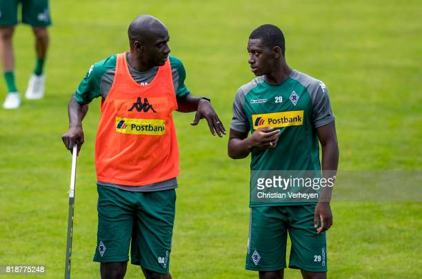 Co Trainer Otto Addo talks to Mamadou Doucoure during a training session at the Training Camp of Borussia Moenchengladbach on July 19 2017 in...
