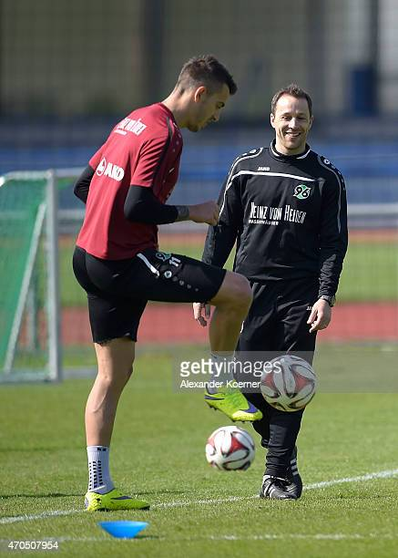 Co Trainer Steven Cherundolo of Hannover 96 attends a training session at HDIArena on April 21 2015 in Hanover Germany Frontzeck follows as Head...