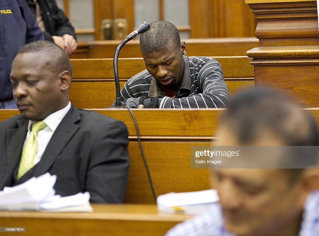 Co-accused Xolile Mngeni sits during the murder trial of Anni Dewani, in the Cape Town High Court, on August 30, 2012 in Cape Town, South Africa. Mziwamadoda Qwabe, who has already been convicted of the murder of the honeymooner, today told the court that Mngeni shot Dewani. The deceased's husband Shrien Dewani remains in Britain fighting extradition as he faces accusations of allegedly plotting her murder.