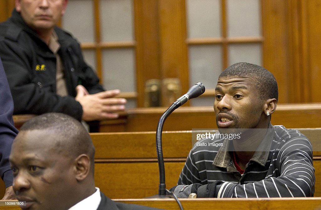 Co-accused Xolile Mngeni speaks during the murder trial of Anni Dewani, n the Cape Town High Court, on August 30, 2012 in Cape Town, South Africa. Mziwamadoda Qwabe, who has already been convicted of the murder of the honeymooner, today told the court that Mngeni shot Dewani. The deceased's husband Shrien Dewani remains in Britain fighting extradition as he faces accusations of allegedly plotting her murder.