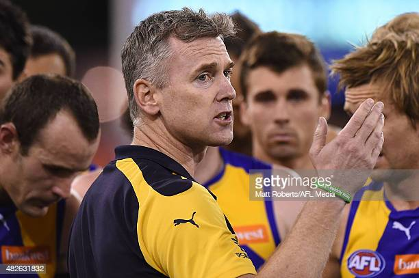 Coach Adam Simpson of the Eagles speaks to his players during the round 18 AFL match between the Gold Coast Suns and the West Coast Eagles at...