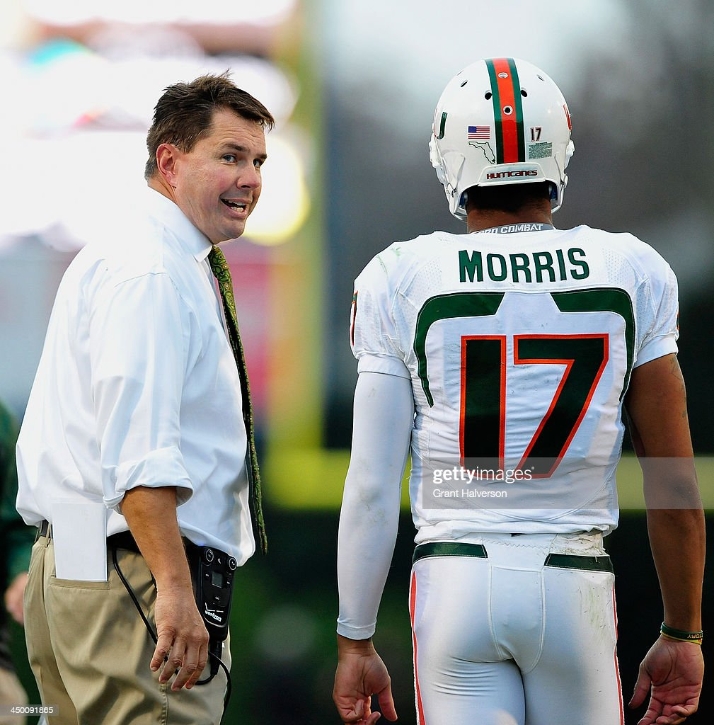 Coach Al Golden has words for quarterback Stephen Morris #17 of the Miami Hurricanes after Morris was called for a 15-yard personal foul against the Duke Blue Devils during play at Wallace Wade Stadium on November 16, 2013 in Durham, North Carolina.