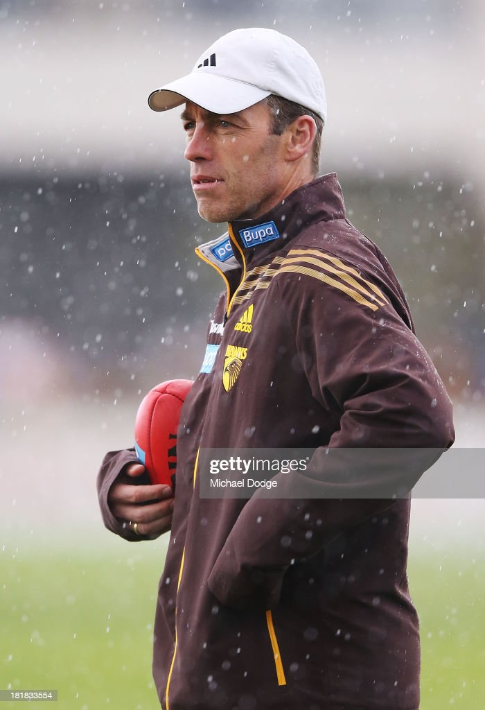 Coach Alastair Clarkson looks ahead in the rain during a Hawthorn Hawks AFL training session at Waverley Park on September 26, 2013 in Melbourne, Australia.