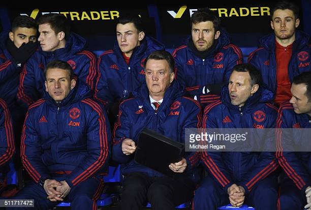 Coach Albert Stuivenberg Louis van Gaal manager of Manchester United and assistant Ryan Giggs look on prior to the Emirates FA Cup fifth round match...