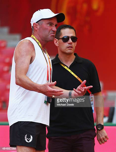 Coach Alberto Salazar and agent Ricky Simms look on ahead of the 15th IAAF World Athletics Championships Beijing 2015 at the Beijing National Stadium...