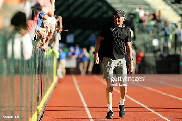 Coach Alberto Salazar looks on as Galen Rupp celebrates after winning the Men's 10000 Meter Final during the 2016 US Olympic Track Field Team Trials...