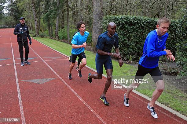 Coach Alberto Salazar of the Nike Oregon Project directs athletes Cam Levins of the Canada Mo Farah of Great Britain and Galen Rupp of the USA as...