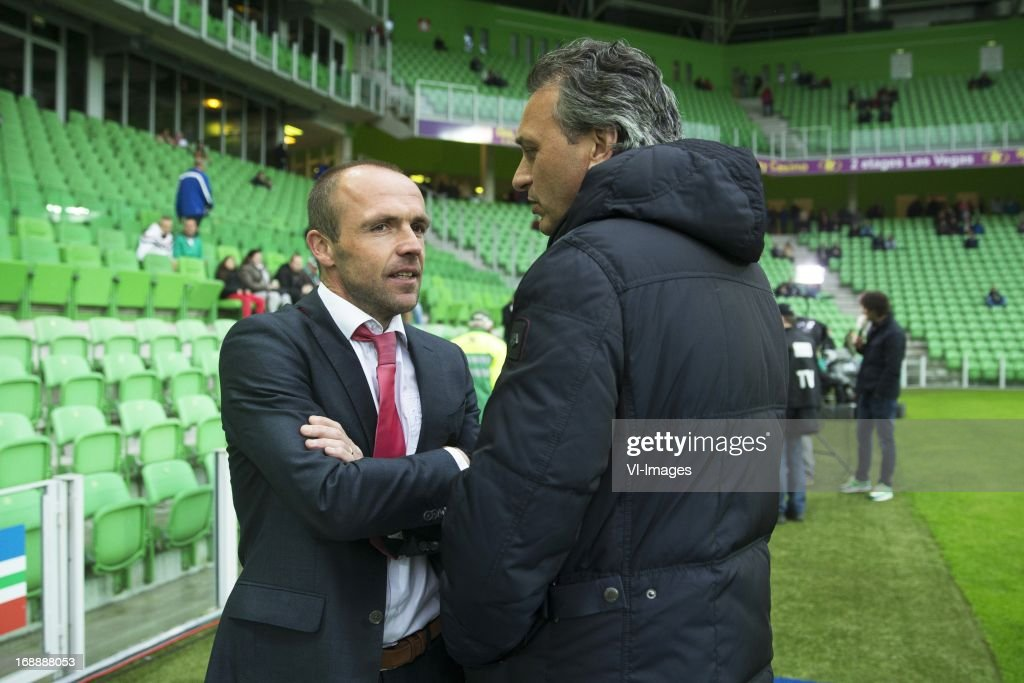 Coach Alfred Schreuder of FC Twente, Coach Robbert Maaskant of FC Groningen during the Eredivisie Europa League Playoff match between FC Groningen and FC Twente on May 16, 2013 at the Euroborg stadium at Groningen, The Netherlands.