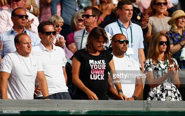 Coach Amelie Mauresmo and Jonas Bjorkman fitness coach Matt Little physio Shane Annun and Kim Murray react during Andy Murray of Great Britain look...