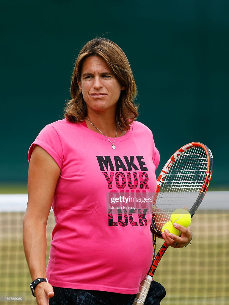 Coach <a gi-track='captionPersonalityLinkClicked' href=/galleries/search?phrase=Amelie+Mauresmo&family=editorial&specificpeople=161389 ng-click='$event.stopPropagation()'>Amelie Mauresmo</a> watches Andy Murray practice on day eight of the Wimbledon Lawn Tennis Championships at the All England Lawn Tennis and Croquet Club on July 7, 2015 in London, England.